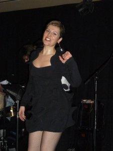 Deborah in black performing at a casino
