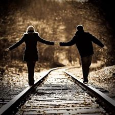 People walking on train tracks